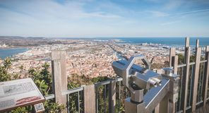 Public telescope on Mount St. Clair overlooking the town of Sete. Sete, France - January 4, 2019: View of a public telescope on Mount St. Clair overlooking the stock photography