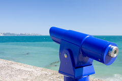 Public Telescope overlooking sea Stock Photo