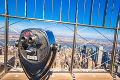 Public telescope pointed on Manhattan buildings Stock Photos