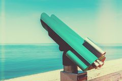 Public telescope at seaside Stock Photo