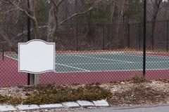 Public Tennis court and around court view form inside fence. Mock up for sign stock photo