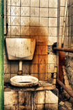 Public toilet. Damaged grunge Public toilet in USSR Royalty Free Stock Photography