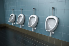 Public toilet. Row of four urinals. 3D rendered image Stock Photos