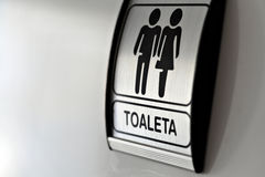 Public toilet. Picture of an aluminum sign on a toilet door Stock Image