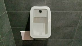 Public toilet with modern equipment in a public place. royalty free stock photography