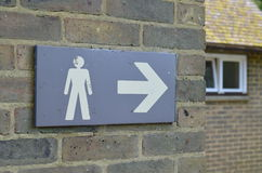 Public toilet sign. Male public toilet sign on exterior wall of building Stock Photo