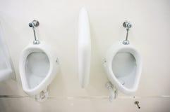Public toilet urinals Stock Photo