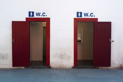 Public toilets with two entrances for men and women. Public services: public bathroom with two entrances for men and women Royalty Free Stock Photography