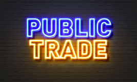 Public trade neon sign on brick wall background. Stock Image