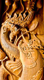 Public Traditional Thai style wood carving serpent naga and fish Stock Photos