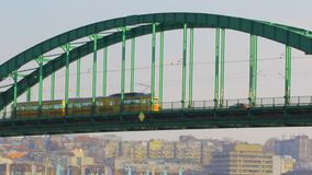 Public traffic on the Sava tram bridge in Belgrade. Yellow tram crossing over the bridge stock footage