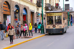 Public tram in the street of Cusco, Peru. In 1983 Cusco was declared a World Heritage Site by UNESCO Royalty Free Stock Images
