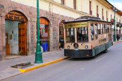 Public tram in the street of Cusco, Peru. In 1983 Cusco was declared a World Heritage Site by UNESCO Stock Photography