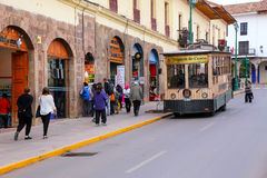 Public tram in the street of Cusco, Peru. In 1983 Cusco was declared a World Heritage Site by UNESCO Royalty Free Stock Photos