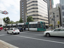Public tram transportation on the streets of Hiroshima. Public tram transportation in Hiroshima city, Japan Royalty Free Stock Images