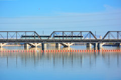 Public Transit Light Rail Train Crossing Bridge over Water. Public Transit Light Rail Train Cars Crossing Bridge over Body of Water stock photography