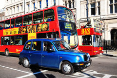 Public transport. London, UK – October 15, 2011: Public transport in Whitehall, Westminster showing a London taxi, a double decker bus and Big Bus tour Stock Photo