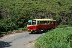 Public transport. Transport bus passing towards a hill station in Kerala India stock images