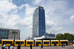 Public transport on the background of a skyscraper at the Alexanderplatz Stock Photo