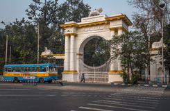 A public transport bus crosses the entrance of the Gothic architectural Governor house near Dharmatala Chowringhee area. Stock Photo