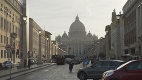 Public transport and cars driving Road of Conciliation towards Vatican City. Stock footage stock footage