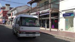 Public transport in a central street of Santa Cruz, Bolivia. BOLIVIA, SANTA CRUZ DE LA SIERRA, 19 JANUARY 2017 - Public transport in a central street of Santa stock footage