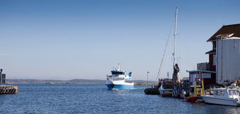 Public transport ferry arriving. At the swedish vacation island of Käringön royalty free stock photography
