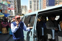 In public transport La Paz barkers who are shouting a bus route. Stock Image