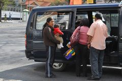 In public transport La Paz barkers who are shouting a bus route. Stock Photos