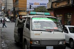 In public transport La Paz barkers who are shouting a bus route Stock Images