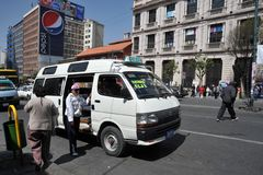 In public transport La Paz barkers who are shouting a bus route Stock Photography