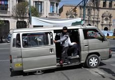 In public transport La Paz barkers who are shouting a bus route Stock Image