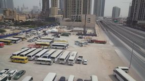 Public Transport Parking in Downtown Dubai stock footage video. Dubai, UAE - April 07, 2018: Public Transport Parking in Downtown Dubai stock footage video stock footage