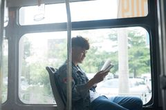 Public transport. people in the bus. Asian man sitting inside ci Royalty Free Stock Image