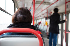 Public transport series - taking a tram commute to work. /school (color toned image; shallow DOF Royalty Free Stock Photography