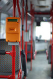 Public transport, ticket puncher. Interior of a modern city bus in Gdansk, Poland royalty free stock photo
