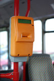 Public transport, ticket puncher. Interior of a modern city bus in Gdansk, Poland Stock Photos