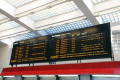 Public transport timetable at a rail station in Italy Stock Photo