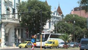 Public transport at traffic lights in the center of Varna, Bulgaria stock footage