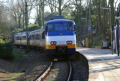 Modern Dutch Sprinter speed train for public transport,Netherlands. Public transport by Sprinter  train in the Netherlands; this train is waiting at the railway Royalty Free Stock Photos
