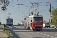 Public transport, tram and trolley across a small  Stock Photo