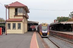 A public transport V/Line passenger train at the Castlemaine railway station platform. CASTLEMAINE, AUSTRALIA - June 9, 2019: A public transport V/Line passenger royalty free stock photo
