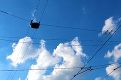 Public transport wires tram line against blue sky Royalty Free Stock Image