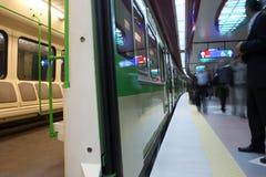 Public transportation. Motion-blur passengers at subway station Stock Photography