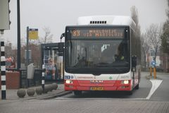 Public transportation bus 33 at Den Hoorn driven by Connexxion in the Netherlands. In white and red color royalty free stock photography