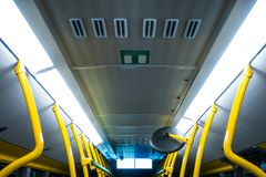 Public Transportation Bus Interior Yellow Poles White Fluorescen. T Stock Images