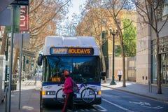 Public transportation bus making a stop, San Jose royalty free stock images