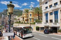 Public transportation bus passes by the street in Monaco, Monaco. Stock Image