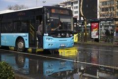 Public transportation bus is waiting for passengers at The Istanbul Kadikoy. Istanbul, Turkey - March 3, 2018 : A public transportation bus is waiting for royalty free stock photos