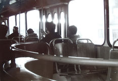 Public transportation. People in a city bus. Analog art photograph. Public transportation. People in a city bus. Analog art photograph with scratches. High Royalty Free Stock Photo